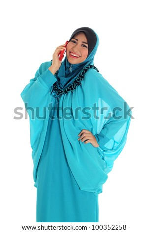 pretty young muslim woman pose with phone isolated on white