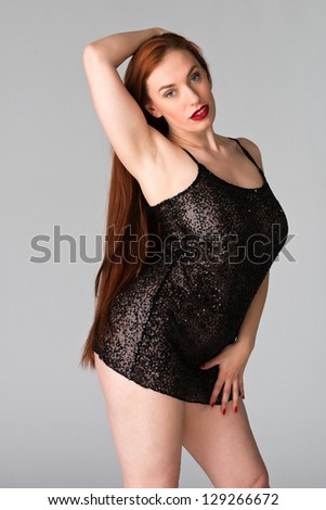Pretty young redhead in a sheer black dress