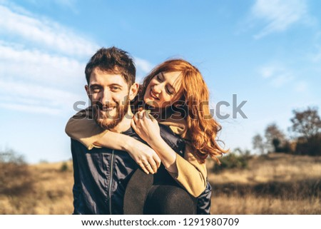 Pretty young romantic couple spend time together outdoor