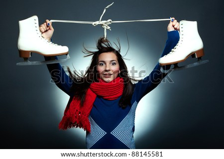 Pretty young smiling girl with the skates