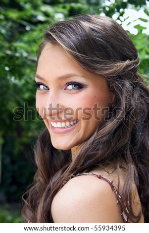 Pretty young smiling woman