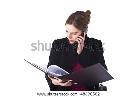 pretty young woman bearing files and using a mobile phone