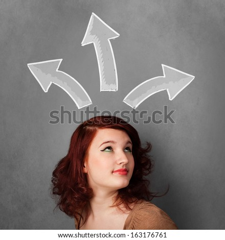 Pretty young woman deciding with sketched arrows above her head