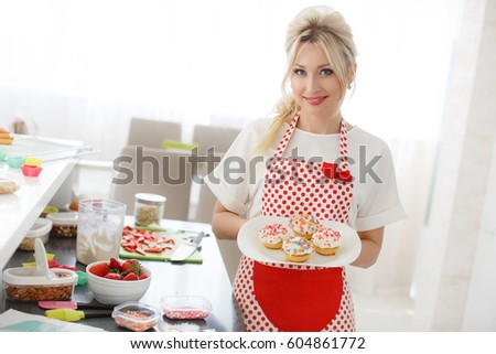 detail pretty young woman decorating cupcakes on her kitchen portrait of a beautiful female business owner - Woman Decorating Cupcakes