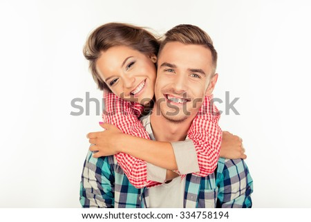 Pretty young woman embracing her boyfriend