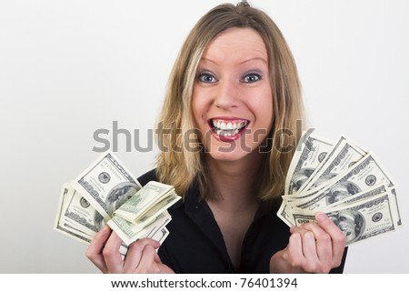 Pretty young woman have lot of US dollars in hundred bills