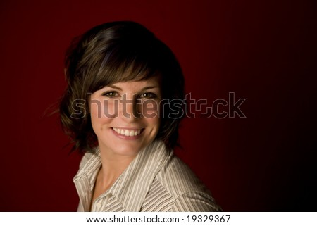 Pretty young woman headshot on red