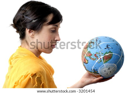 pretty young woman holding the world in her hand