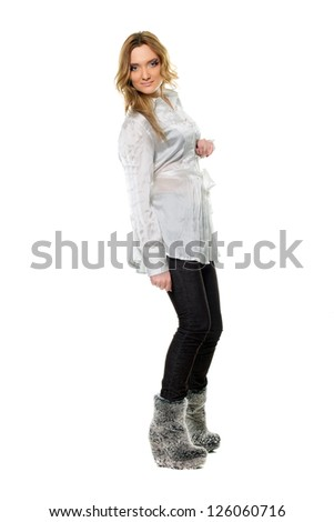 Pretty young woman in a jeans and shirt. Isolated
