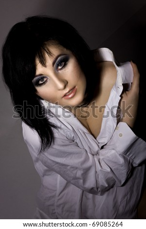 Pretty young woman in a white men's shirt