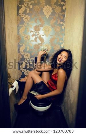 pretty young woman in restroom with money