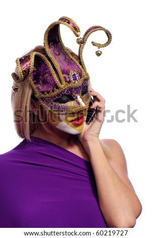 pretty young woman in violet mask speak on the phone, isolated on white