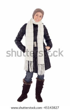 Pretty young woman in warm winter clothes, isolated on white.