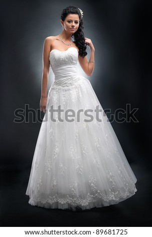 Pretty young woman in white wedding dress with flower in her head - series of photos