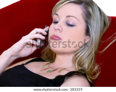 Woman Laying On A Velvet Couch Pouting Talking Cell Phone Stock