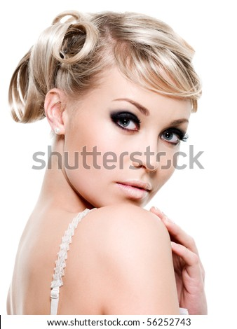 Pretty young woman looking at camera - isolated on white