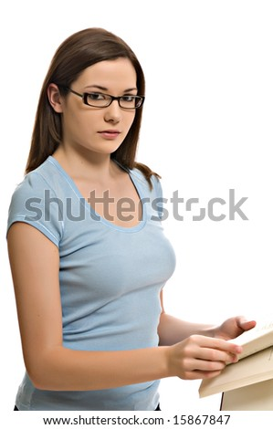 Pretty young woman looks up from her book