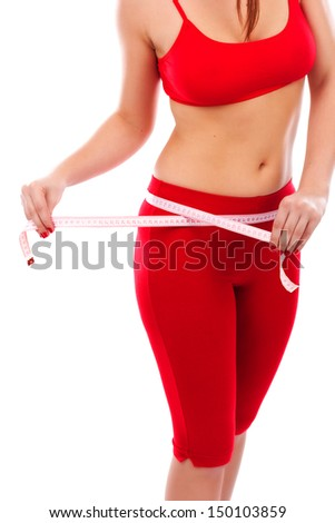 Pretty young woman measuring her body, healthy lifestyles concept, on white background