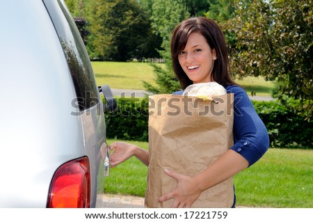 Pretty Young Woman Opening The Tailgate Of Her Sport Utility Truck