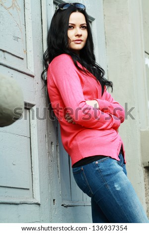 Pretty young woman outdoor in a casual lifestyle pose