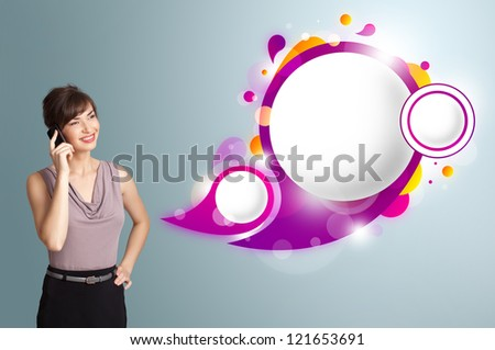 Pretty young woman presenting abstract speech bubble copy space and making phone call