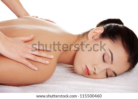 Pretty young woman relaxing being massaged isoalted on white