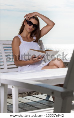 Pretty young woman relaxing on the beach