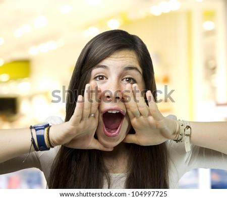 pretty young woman shouting