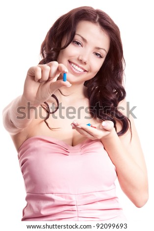 pretty young woman taking pills, isolated against white background (focus on the face)