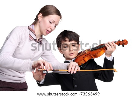 pretty young woman teaching little handsome boy to play a violin