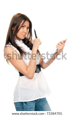 Pretty young woman thinking, holding pen and a notebook textbook in her hands on a white background.