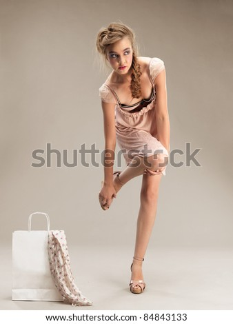 pretty young woman tired from shopping resting