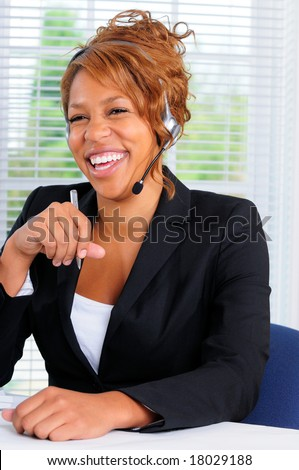 Pretty Young Woman Using A Computer In A Call Center Office