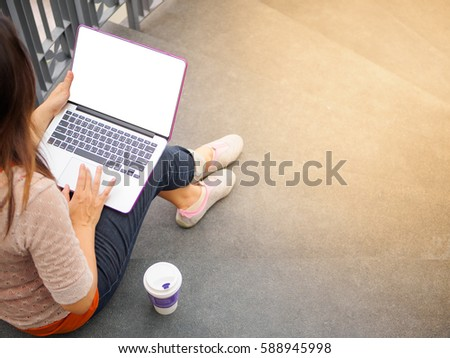 Pretty Young woman using laptop computer. Female working on laptop in an outdoor cafe. stock photo