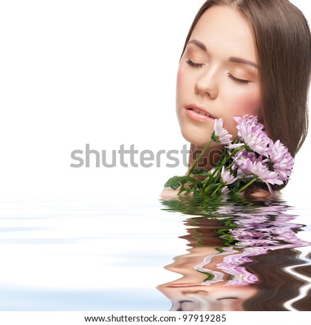 Pretty young woman with beautiful fresh make-up with flowers standing in water
