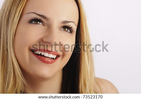 Pretty young woman with beautiful teeth and long eyelashes