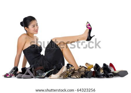 pretty young woman with buying shoes addiction, isolated on white background