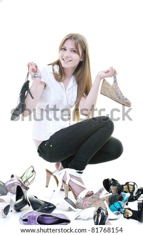 pretty young woman with buying shoes addiction, isolated on white background in studio