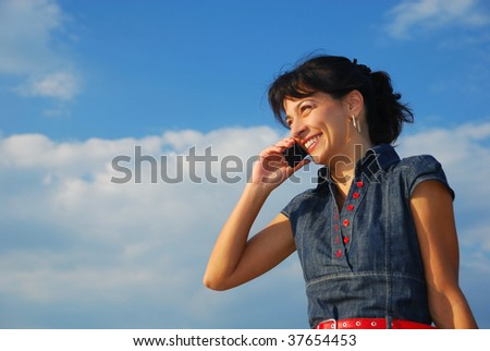 pretty young woman with cell phone, laughing