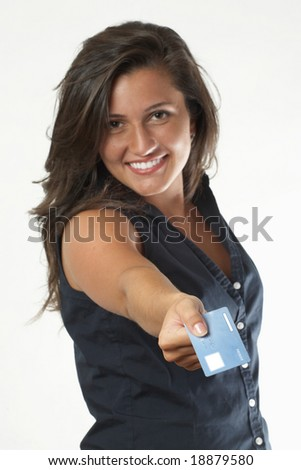 Pretty young woman with credit card for shopping, focus on hand
