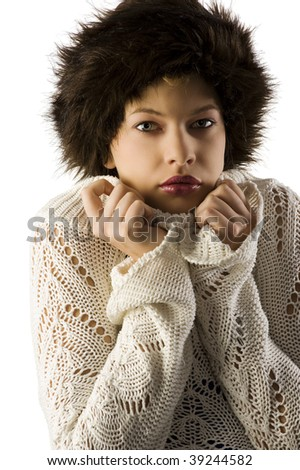 pretty young woman with fur hat in act to repair repair herself from a cold