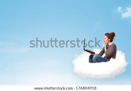 Pretty young woman with laptop sitting on cloud with empty space #176804918