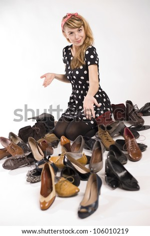 pretty young woman with many shoes, on white background