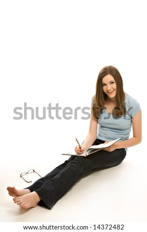 Pretty young woman with notebook