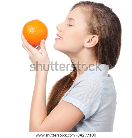 Pretty young woman with orange isolated on the white background