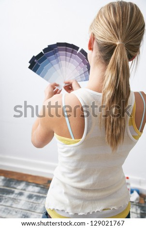 Pretty young woman with painting