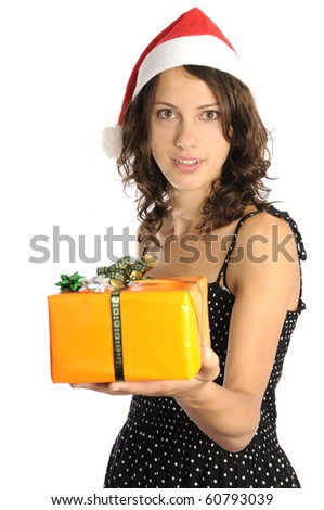 Pretty young woman with santa hat holding christmas gift