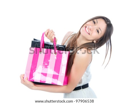 Pretty young woman with shopping bags buying presents, smiling and looking at the camera isolated on a white background