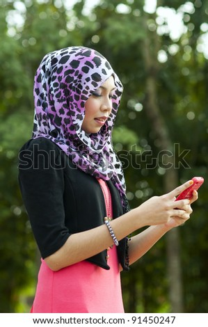 pretty young women use a cellphone