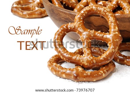 Pretzels with wooden bowl on white background with copy space.  Macro with shallow dof.